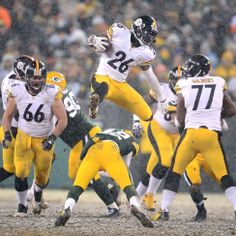 Steelers Le Veon Bell leaps over Packers Morgan Burnett for first down  yardage in the third quarter at Lambeau Field. Pittsburgh Steelers ea590395b