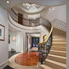 Elegant foyer with black wrought ironed staircase rails