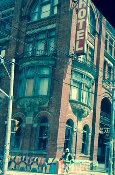 The Gladstone Hotel , a Parkdale landmark was built in 1889, and is the oldest continuously operating hotel in Toronto. In addition to serving the three major railway companies  it provided visitors attending the Canadian National Exhibition (CNE) a place to stay.  Refurbished to reflect Parkdale's  changing  social scene  it is today an Uber Chic  Art Hotel. Active music scene and indie/hipster haunt .  Eclectic 'Queen Street West 'keeps moving westerly. Visit Toronto, Toronto Canada, The Places Youll Go, Places To Visit, Gladstone Hotel, Queen Street West, Indie Hipster, Cityscapes, Gta