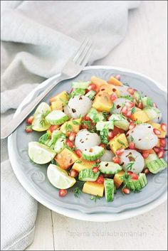 A light, colourful and exotic summertime cucumber, papaya and lychee salad with pomegranate dressed with honey, lime and red chilli flakes.