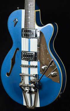 """During Pearl Jam's of """"Porch"""" for the Austin City Limits show, Eddie Vedder plays this blue Duesenberg Mike Campbell (Tom Petty & The Heartbreakers) Signature TV Guitar.  The guitar looks so nice that the crowd starts to cheer for the guitar itself."""