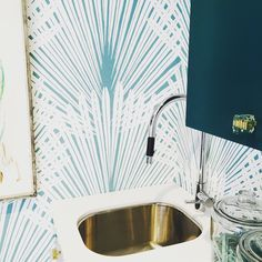 Palm wallpaper in the laundry room at the Christopher Kennedy Compound in Palm Springs.  Design by Denise McGaha