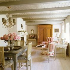 Romantic Cottage Living Room Bleached-pine floorboards brighten up this small space.