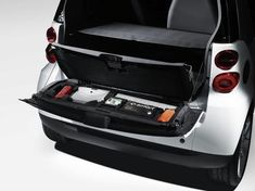 2-part foam insert for the storage compartment in the tailgate, with 2-part lid and additional accessoriesPrinciple the same as for smart fortwo cabrio's roof bar storagePackage contains an emergency jacket, warning triangle, first-aid kit, torchThere is also a spare compartment which can be used for the vehicle operating manual, for exampleFor conveniently simple storageEverything is integrated in a clever, space-saving way into the tailgate, but quickly accessible when neededNo space is…