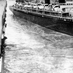 As the Titanic sailed out of Southampton, her huge displacement caused the mooring lines on the SS New York to break, and the New York's stern swung out and nearly hit the Titanic, as seen in this picture