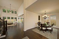 Oak Forest Home Ready For Move-In - 3,386 Sq. Ft. - Foyer, Dining Room & Family Room - #PerryHomes #trustedbuilder #OakForest #HoustonHeights #TheHeights #HoustonHomes #realestate #relocatingtohouston #houstonenergycorridor #openconcept #openfloorplan #interiordesign #homebuilding #homebuying #summersalesevent #diningroom #familyroom #woodfloors #wallofwindows