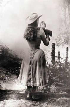 """historicaltimes: """" Annie Oakley shooting over her shoulder using a hand mirror, 1888 """""""