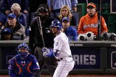 Baseball fan Laurence Leavy, right, watches during the 12th inning of Game 1 of the Major League Baseball World Series between the Kansas City Royals and the New York Mets Tuesday, Oct. 27, 2015, in Kansas City, Mo. (AP Photo/Charlie Riedel)