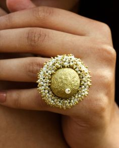 Faux Pearl shimmer ball ring.Hold on the glamour with this shimmer ball studded pearl bunch ring.