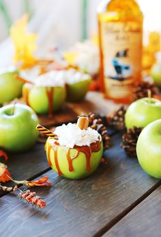 This Spiced Caramel Apple cocktail recipe is perfect for the fall and Halloween! Crisp, tart, and a treat inside. Carve out the inside of your apple of choice. Drizzle caramel both inside and outside of the apple and then fill with the ingredients. Swirl whip cream on top. Add your favorite island straw to make it look fa-BOO-lous. #bluechairbay #spicedrum #BCBHappyHour Fall Cocktails, Spiced Rum, Caramel Apples, Cocktail Recipes, Fall Recipes, Happy Halloween, Tart, Spices, Treats