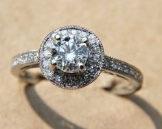 """Item #Bph002 Ask her to marry you with this stunning, halo, diamond engagement ring with infinity symbol on the band. This ring is a custom made ring. ----------DIAMOND GIVEAWAY---------- We are ALWAYS giving away diamonds, so like """"Beautiful Petra on Facebook and enter the current contest! http://www.facebook.com/BeautifulPetra >>>If you like it, PIN it!<<< ----------QUESTIONS?---------- PLEASE READ the FAQ before contacting us with a question: https:&..."""