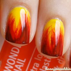 Make your nails seriously hot with an intense flame design. The style requires a bit more experience, but with a few tries can be created with ease. Just a few strokes of the brush in the right direction turns your nails from cool to smokin' hot! Don't forget to use the right colors like black, yellow, and red!