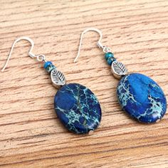 Susen Foster's Blue Hawaii Earrings - These earrings feature beautiful blue variscite stones with varying fills from greens to tans in a lovely and eye-catching design. Silver plated earrings are handmade in the United States - natural stone. Artist's favorites.