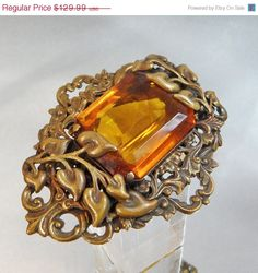 FALL SALE Vintage Art Nouveau Brooch.  Huge. Gilt. Amber by waalaa, $110.49       This vintage torsade necklace is absolutely gorgeous! It features a torsade style necklace of tiny glass bugle beads in shades of fuchsia, lavender and purple gathered at both sides with a gold bead and a gold wrapped silk cord which is adjustable. A perfect addition to your vintage jewelry collection!
