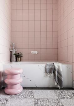 This retro-style bathroom featuring square pink tiles, a striking marble bath tu. This retro-style bathroom featuring square pink tiles, a striking marble bath tu. Bathroom Styling, Bathroom Interior Design, Stone Flooring, Bathroom Furniture, Bathtub Design, Marble Bathroom, Pink Tiles, Pink Bathroom, Marble Bath
