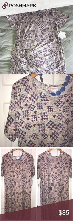 """Lularoe XL Aztec Carly, Mega Unicorn 🦄🦄 Absolutely FABULOUS and super trendy print, on my favorite Lularoe dress! It doesn't get any better than this and it's so easy to see why this is SUCH a popular piece! Perfectly trendy and ready for fall, throw on a denim vest and booties and you're ready to go! Light gray background, dark gray speckles, purple and teal triangular Aztec pattern. Carly sizing is VERY flexible, I can wear M-2X, don't be afraid of sizing up! Appx 48""""L in back, 42""""L in…"""