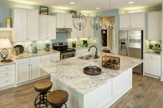 Olivia B: Uneven cabinet look, light fixtures, recessed lighting, island bar, countertops w/ white cabinets