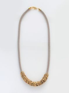 brika grey brass loops necklace by reason to be pretty.