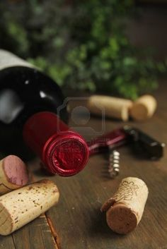 Cork Wine On A Wooden Table With Red Corkscrew And A Bottle Of..