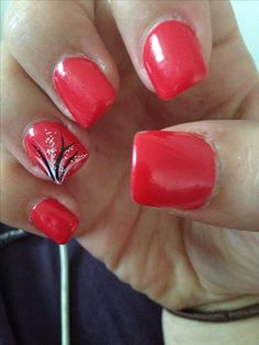 Acrylic red orange nail with art on ring finger
