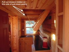 Pull down pantry in a Tiny House kitchen.  There are also drawers that pull out from the side where the pantry doors latch in (visible in the YouTube tour video):  Baxa Tiny House