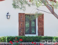 Rustic architectural shutters such as these go a long way when improving the architectural essence of a custom home. Adding  these lightly stained rustic shutters to this home's windows defined the Spanish style of this home.