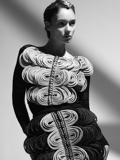 Textile Manipulation for Fashion Design - wax cord embellished dress with repeating spiral disc pattern & texture; wearable art // Derek Lawlor