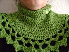 Crochet green button scarf.
