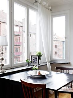 The perfect kitchen for young 20 somethings  | I just love this    Windows and simple curtains make all the difference.
