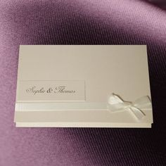 An elegant pearlised Invitation with satin ribbon. Your names are printed on a separate panel which affixes to the front of the folded wallet. Our simplicity invitations are supplied fully assembled.