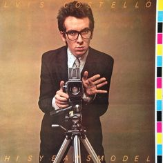 Elvis Costello - This Year's Model  Barney Bubbles album cover 'misprints' the image, cutting off letters and keeping the printer's colour bar in the image.