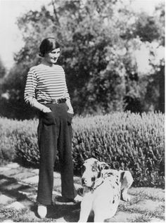 """Chanel at her house """"La Pausa"""" in the French riviera with her dog Gigot 1930. """"Some people think luxury is the opposite of poverty. It is not. It is the opposite of vulgarity."""""""