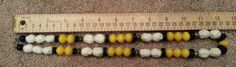 Vintage beaded necklace in white, yellow and black
