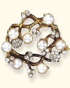 A CULTURED PEARL AND DIAMOND FOLIATE BROOCH, BY TIFFANY & CO. Designed as intertwining polished gold branches, enhanced by scattered cultured pearls, measuring approximately 6.20 mm, diamond collets and revolving circular-cut diamond floret motifs, mounted in 18k gold Signed Tiffany & Co.