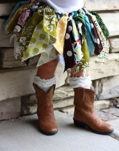 cute!! I bet you could make this like a tutu, with elastic and either bandanas or fabric scraps. Cute for a little country princess :)