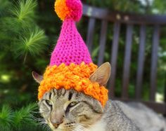 For cats and small dogs, this handmade flower cat hat is crocheted by hand with 100% cotton, and uses your pets unique measurements to ensure a tailored fit. Each custom cat hat is made from a washable and durable cotton yarn that is ideal for warmer weather. The headpiece features a mixture of springtime colors as well as comfy ear holes, two simple ties for fastening, and a double layer flower applique. Please, remember to provide your pets measurements (and breed, if for a dog) at…