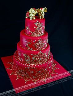 Red and gold henna design inspired wedding cake