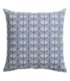 Dark blue. Cushion cover in cotton canvas with a printed pattern at front and solid-color at back. Concealed zip.