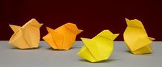 four yellow origami chicks
