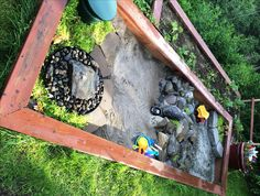 Natural play garden space for my boy incorporates a fountain, a sand box, a gravel pit, a mountain with a tunnel for vehicles to pass through and planted green space for his dinosaurs to hide.