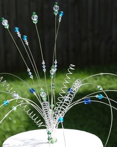 CUSTOM Wedding Cake Topper Unique DECOR Wire, Swarovski crystal And Glass Beads CHOOSE Your Colors. $99.99, via Etsy.