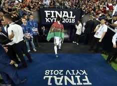 Bale walks down the tunnel proudly donning a Wales flag over his shoulders as supporters c...