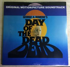 Day Of The Dead LP Original Soundtrack George Romero Vintage Saturn Records Vinyl George Romero, Love Post, Dead Zombie, Mug Shots, Day Of The Dead, Soundtrack, Vinyl Records, Seal, Horror