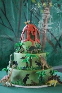 Jared's buttercream-iced Bar Mitzvah cake with edible palm trees and toy dinosaurs.
