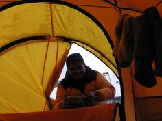 Wake up! Ganesh has hot soup before we climb Pokalde Peak; mountaineering in the Khumbu, Nepal.