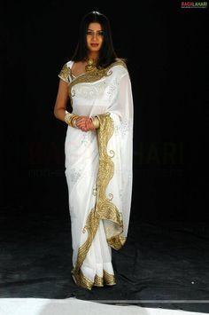 gold saris | Exquisite, regal, glowing white and gold saree designer saree