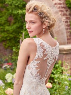 Rebecca Ingram - piper, This simple sheath lace wedding dress evokes grace and charm, featuring a classic V-neckline, illusion straps, and illusion back accented in lace motifs. Finished with covered buttons over zipper closure.
