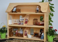 Hey, I found this really awesome Etsy listing at https://www.etsy.com/listing/125056467/handcrafted-natural-wooden-toy-dollhouse