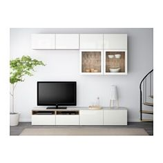 IKEA - BESTÅ, TV storage combination/glass doors, walnut effect light gray/Selsviken high gloss/white clear glass, drawer runner, push-open, , The drawers and doors have integrated push-openers, so you don't need handles or knobs and can open them with just a light push.The tempered glass top panel protects the top of the TV bench and gives it a different look.The cord outlet at the top lets cords and cables run down smoothly even if the TV is mounted on the wall.It's easy to keep the cords…