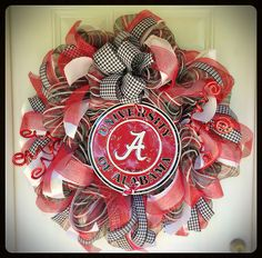 Alabama Crimson Tide Mesh Wreath with tin sign.  I used 5 different types of ribbon for this special wreath. Roll Tide!
